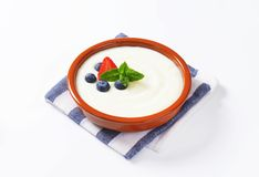 Smooth semolina porridge with fresh fruit Royalty Free Stock Photography