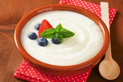 Smooth semolina porridge with fresh fruit Royalty Free Stock Image