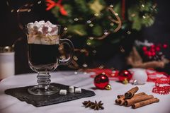 Smooth shady christmas and new year decoration background with round bokeh and cup of coffee with marshmallow. Smooth shady christmas and new year decoration royalty free stock photos