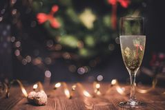 Smooth shady christmas and new year decoration background with round bokeh, golden ribbon and champagne and cork. Smooth shady christmas and new year decoration royalty free stock images
