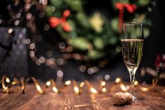 Smooth shady christmas and new year decoration background with round bokeh, golden ribbon and champagne and cork. Smooth shady christmas and new year decoration royalty free stock photo