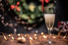 Smooth shady christmas and new year decoration background with round bokeh, golden ribbon and champagne and cork. Smooth shady christmas and new year decoration stock photo