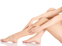 Smooth, shaved woman's legs. Stock Images