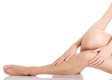 Smooth, shaved woman's legs. Royalty Free Stock Image
