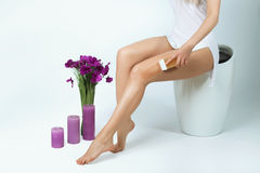 Smooth and silky female feet. Depilation. Shugaring. Beautiful slender female legs with silky skin, hair removal, depilation, shugaring Royalty Free Stock Image