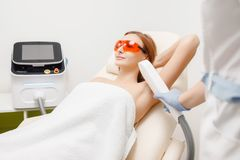 Smooth skin woman under arms. Laser hair removal stock photography