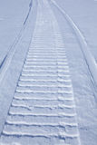 Smooth snow with snowmobile trail Stock Images