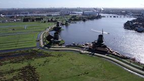 Aerial video of famous dutch windmills at the Zaanse Schans. Smooth stabilized aerial 4k video of the famous dutch windmills at the Zaanse Schans near Amsterdam stock video