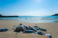 Smooth stones on the beach, sea rest royalty free stock photography