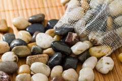 Smooth stones or pebbles. Pile of smooth stone of pebbles in different shades of color Royalty Free Stock Photos