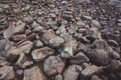 Smooth stones in the river in the background. royalty free stock images