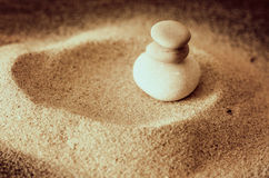 Smooth stones and sand Stock Photo