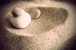 Smooth stones and sand Royalty Free Stock Images