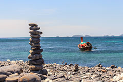 Smooth stones stacked on each other on the beach. Tower of stones for meditation on a sea royalty free stock photo
