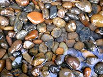 Smooth Stones in Water Stock Photo