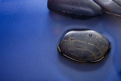 Smooth stones in water Royalty Free Stock Photography