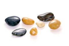 Smooth stones on white Royalty Free Stock Photos