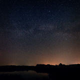 Smooth surface of the lake on  background the starry sky Stock Photo