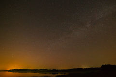 Smooth surface of the lake on  background the starry sky Stock Photos