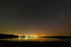 Smooth surface of the lake on  background the starry sky Royalty Free Stock Photography