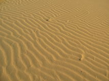 Smooth surface of the sand with waves in the desert Royalty Free Stock Photography