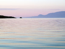 Smooth Textured Water, Dawn Light Stock Photo