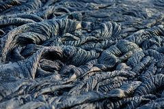 Free Smooth, Undulating Surface Of Frozen Pahoehoe Lava. Frozen Lava Wrinkled In Tapestry-like Folds And Rolls Resembling Twisted Rope Royalty Free Stock Photos - 116708688