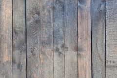 Smooth vertical boards. Old wooden fence with faded wood. Blank background. stock photo