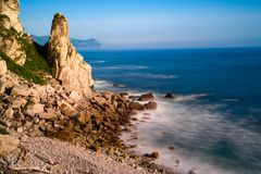 Smooth water. Surf of coastal rocks and cliffs shot on slow shutter speed Stock Photo