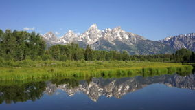 Smooth Water Reflecting Mountains Grand Teton National Park stock footage