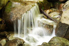 Smooth water of a waterfall Royalty Free Stock Photos