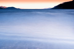 Smooth waters of nordic sea background Royalty Free Stock Photos
