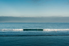 Smooth waves in the ocean. Waves in the ocean at a beach in port fairy located along the great ocean road in australia Stock Photos