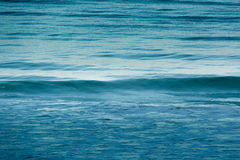 Smooth waves in the ocean. Waves in the ocean at a beach in port fairy located along the great ocean road in australia Stock Images