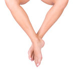 Smooth woman's legs. Smooth female legs isolated over white Royalty Free Stock Photography