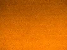 Smooth Wood Grain Background. Section of golden brown smoothly finished wood Royalty Free Stock Image