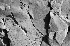 Smoothed face igneous rock. Smooth faced igneous rock with interesting fissures and crack patterns stock photo