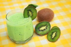 Smoothie. Green smoothie and fresh kiwi on yellow tableclothes Stock Photo
