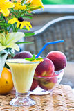 Smoothie. Orange Julius with fresh fruit in an outdoor setting Royalty Free Stock Image