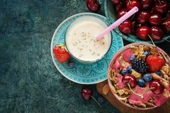 Smoothie and almond milk. Smoothie bowl with fresh berries, nuts, seeds, fruit. Healthy breakfast and almond milk stock photos