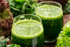 Smoothie from arugula, lollo rossa, spinach, lettuce and mint Royalty Free Stock Image