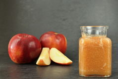 Smoothie in background apple. On the image is popular apple shake with small piece apple royalty free stock photos