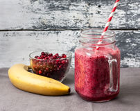 Smoothie of banana and berries Stock Photography