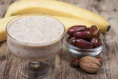 Smoothie with a banana with dates and nuts  . Royalty Free Stock Image