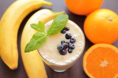 Smoothie with banana and orange stock photography