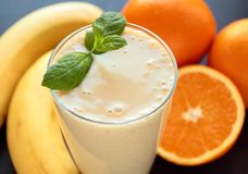Smoothie with banana and oranges fruits Stock Image
