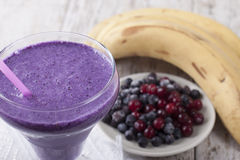 Smoothie of banana, pineapple, cranberry and blueberry  with yog. Smoothie of banana, canned pineapple, frozen cranberries and blueberries with yogurt Royalty Free Stock Image
