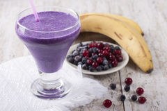 Smoothie of banana, pineapple, cranberry and blueberry  with yog. Smoothie of banana, canned pineapple, frozen cranberries and blueberries with yogurt Royalty Free Stock Photo