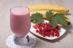 Smoothie of banana with red currant Royalty Free Stock Photos