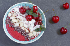 Smoothie bowl with cherry, coconut, almond and chia seeds stock photos